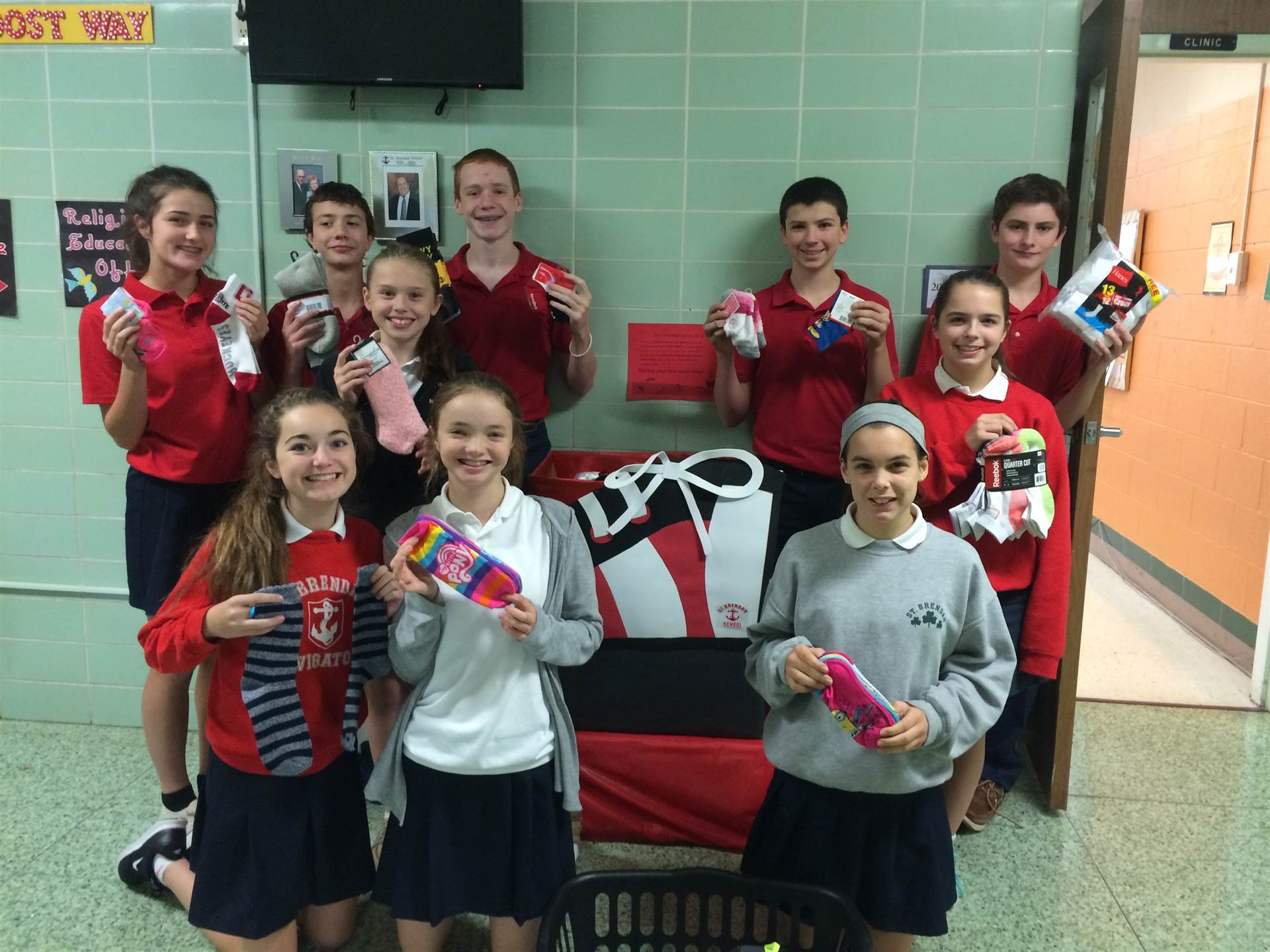 Students pose to promote Socktober. An annual sock collection for the Westside Catholic Center
