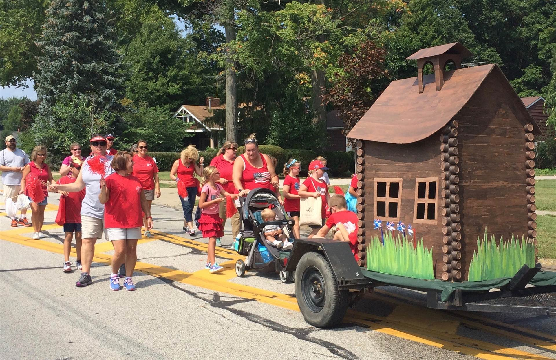 Students, faculty, and parents participate in the North Olmsted Homecoming Parade