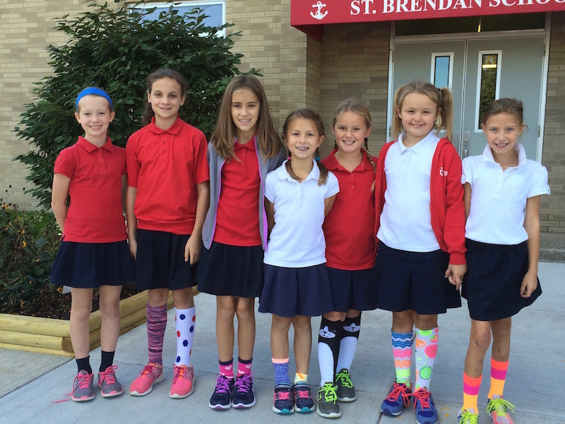 Students show their support for SOCKtober and the West Side Catholic Center