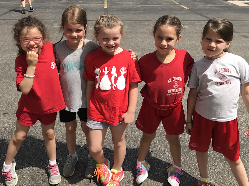 Students pose for a picture at recess