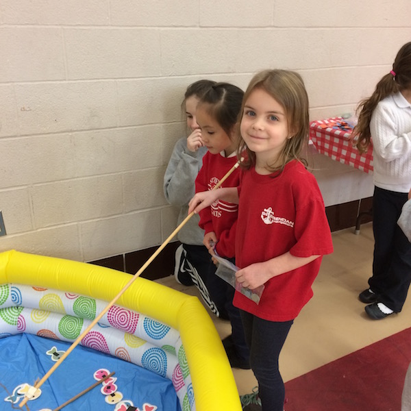 Students enjoy a game at the math carnival