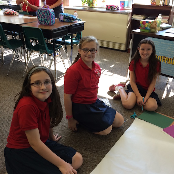 Students create a poster in a group project
