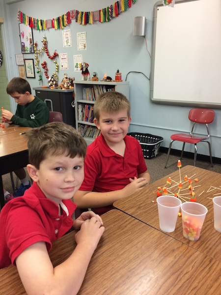 Two boys construct a tower with candy corn and toothpicks in this STEM activity