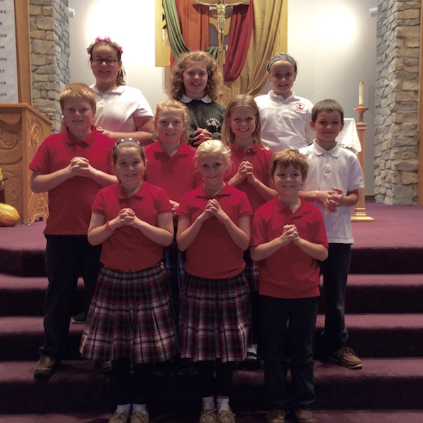 Students prepare to perform in church