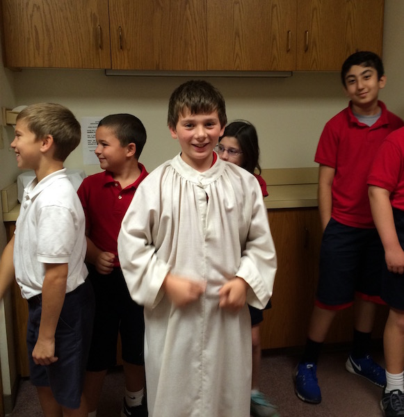 boy prepares to serve mass