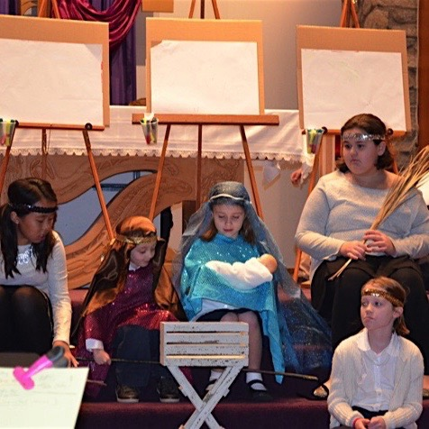 students practice the nativity scene for the annual Christmas program