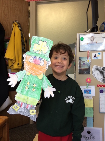 boy shows his leprechaun project