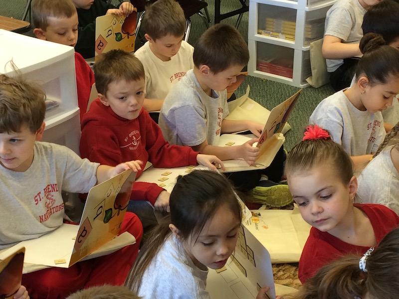 Kindergarten students work on their ABCs