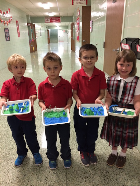 Students show off their landform dioramas