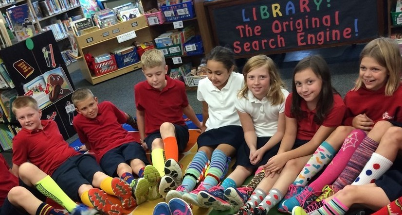 Students show their support for the Westside Catholic Center sock collection