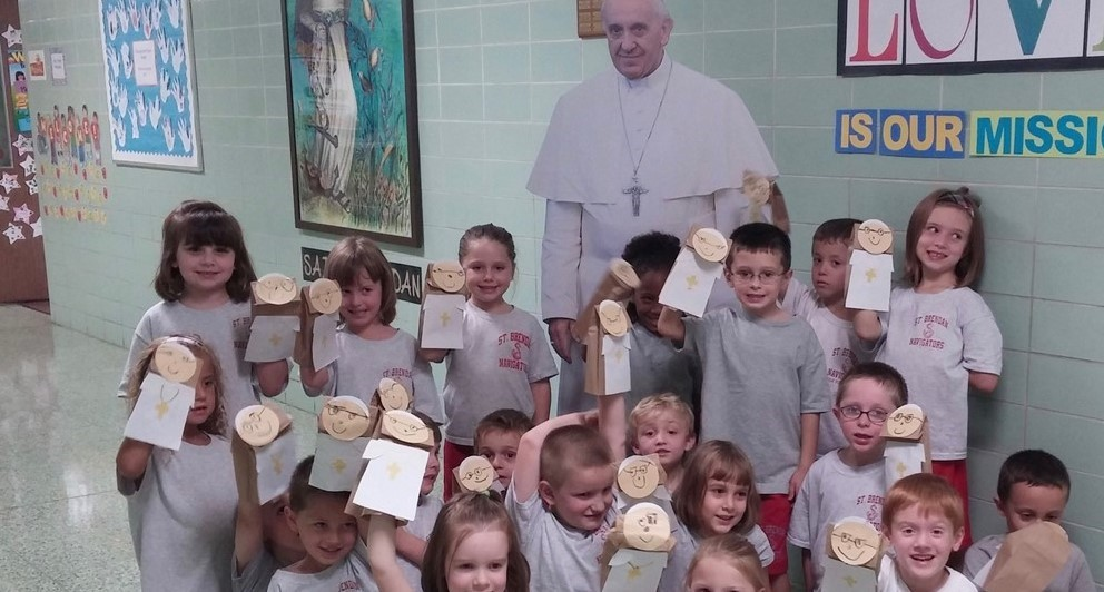 Kindergarten show off their Pope Francis puppets
