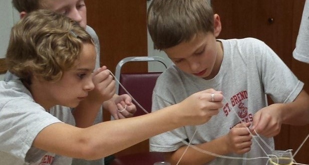 Students work together to solve the STEM problem in science lab