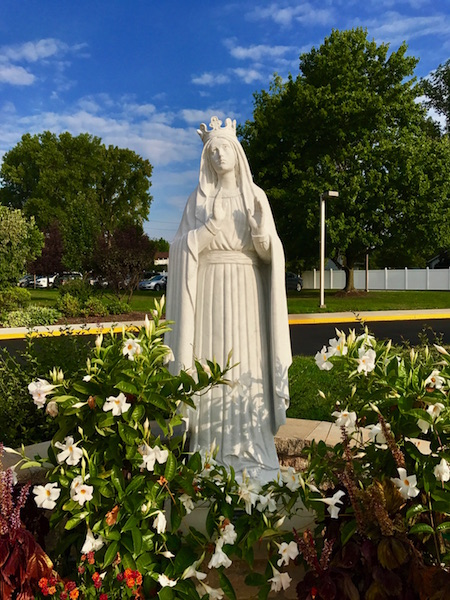 Our Lady of Knock statue in the prayer garden in front of St. Brendan Church with a picture perfect