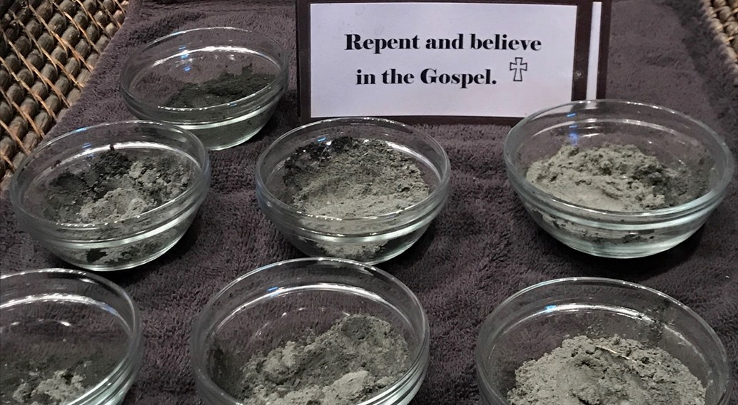 Ashes on Ash Wednesday with caption, Repent and Believe in the Gospel