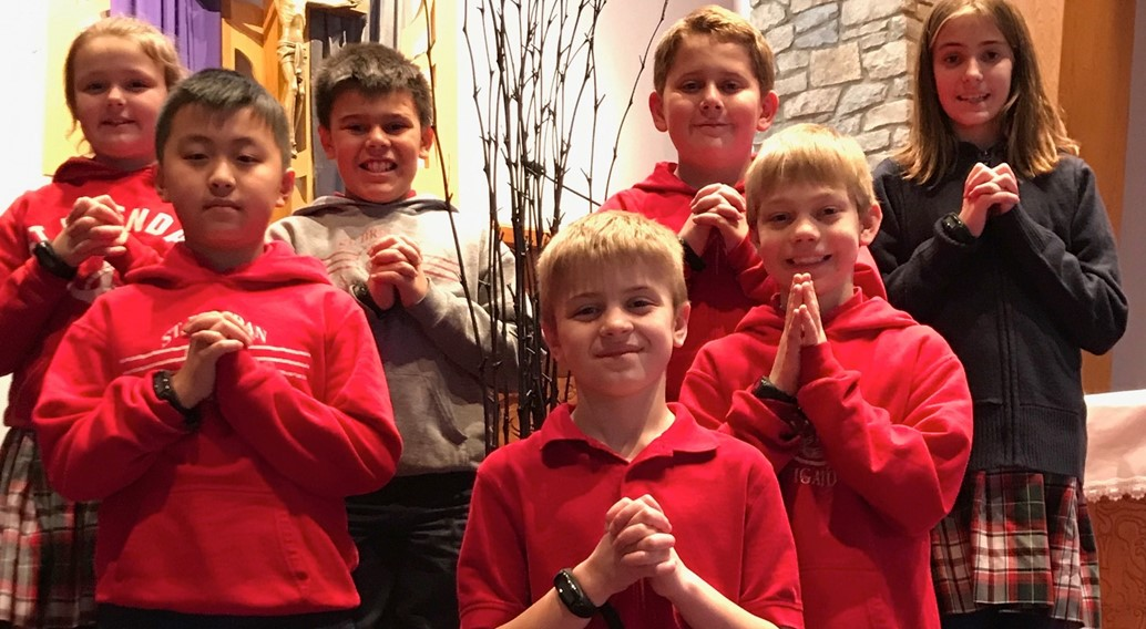 School children pose for a picture on Ash Wednesday