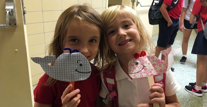kindergarten girls show their whales received at the earlier rally