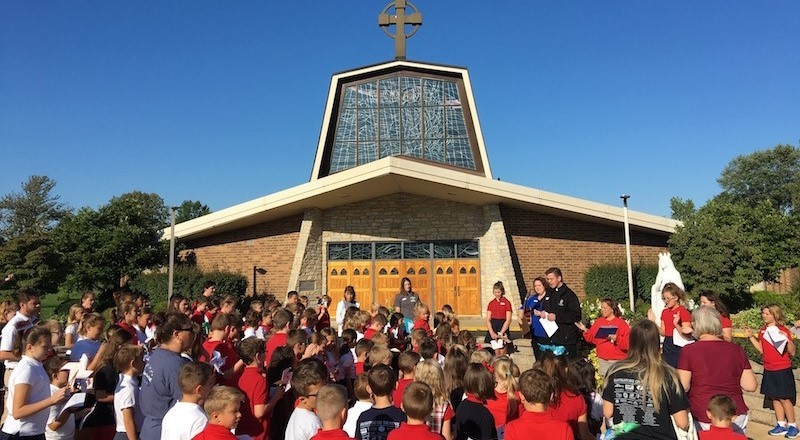 student body have a prayer service for peace in Our Lady of Knock prayer garden