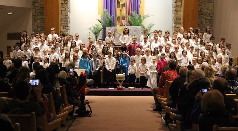 school children on the sanctuary stairs performing their Annual Christmas Program