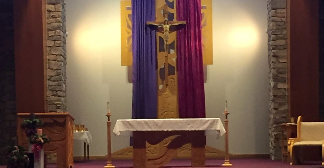altar adorned in purple and rose for advent