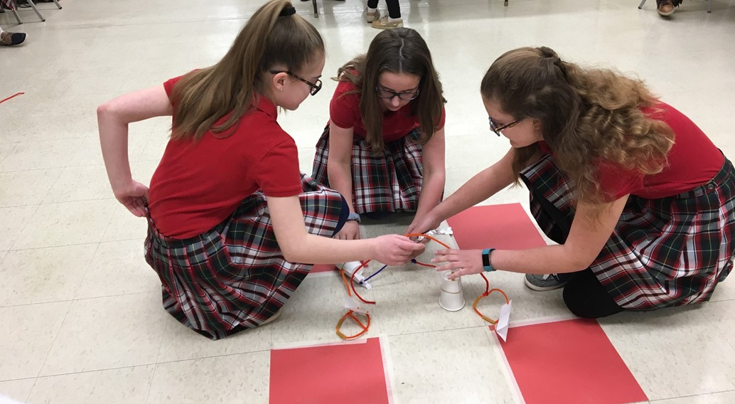 Jr. High girls collaborate on a STEM challenge during Waves of Enrichment