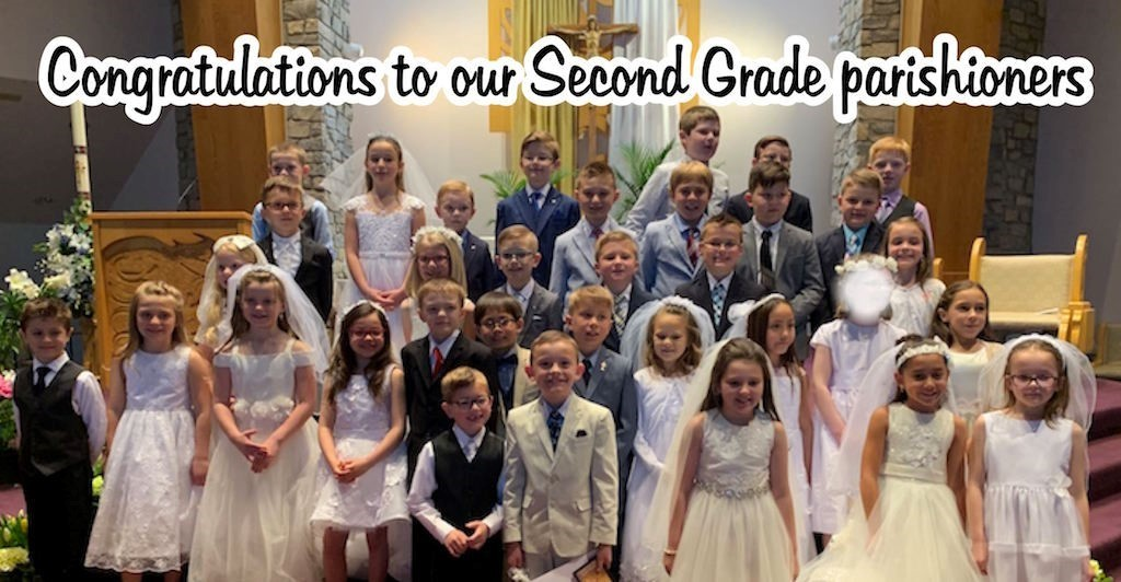 second grade communicants in their suits and dresses