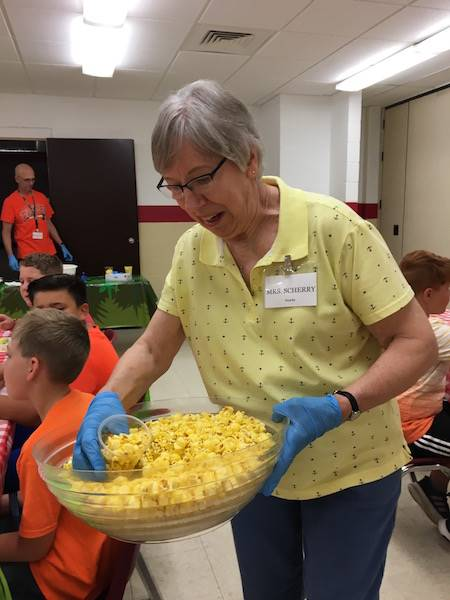volunteer passes out snacks