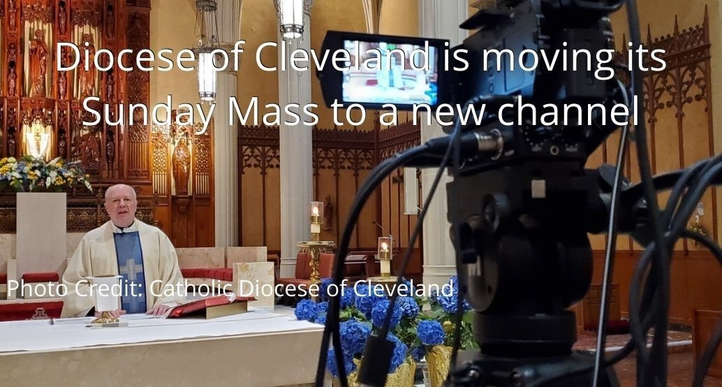 Photo of mass being filmed showing priest at altar in st john cathedral with camera filming. Diocese of Cleveland is moving its Sunday Mass to a new channel