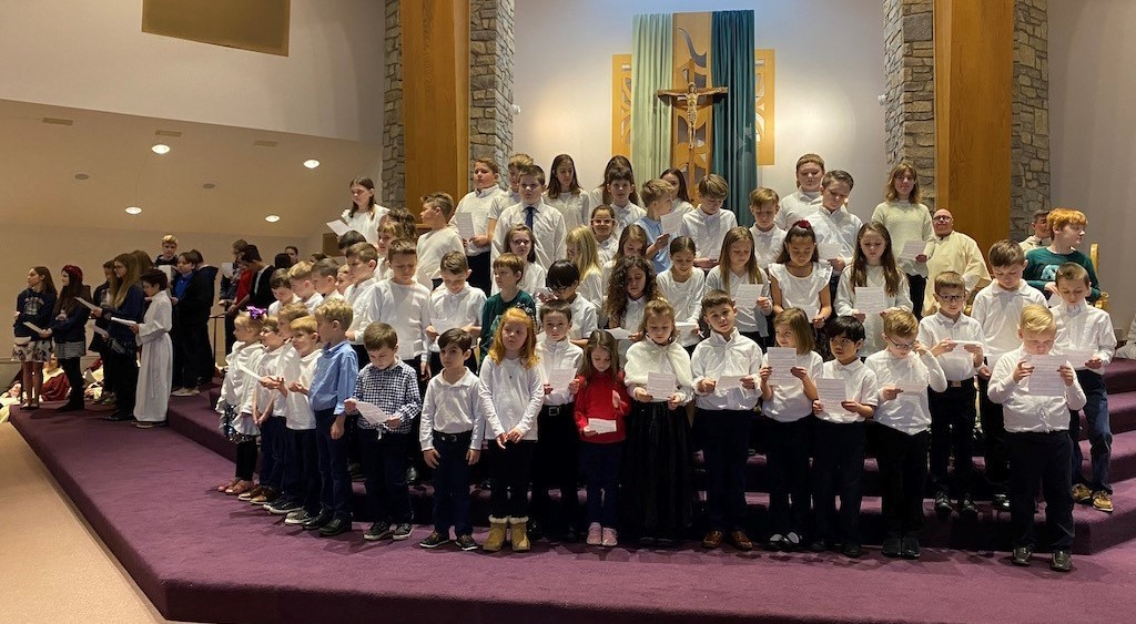 school children sing at sunday mass
