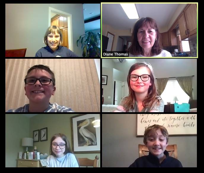 zoom meeting kids each in a screen with remote learning