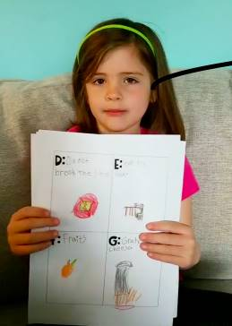 girl showing her A to Z project
