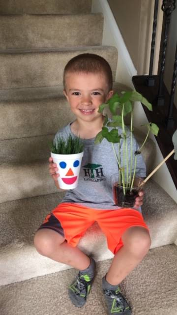 boy showing his plants