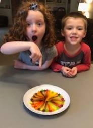 girl and boy with surprised looks of what they made