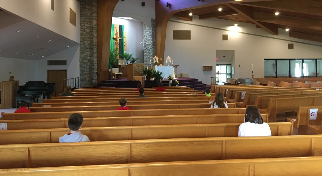 Students take time to reflect and pray during Adoration