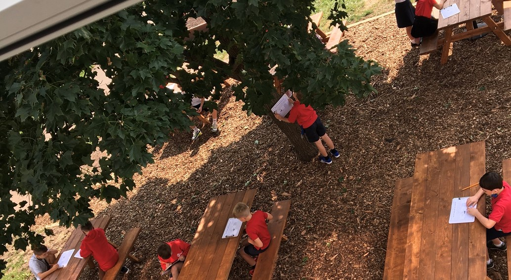 3rd grade students enjoy class in the outdoor learning space