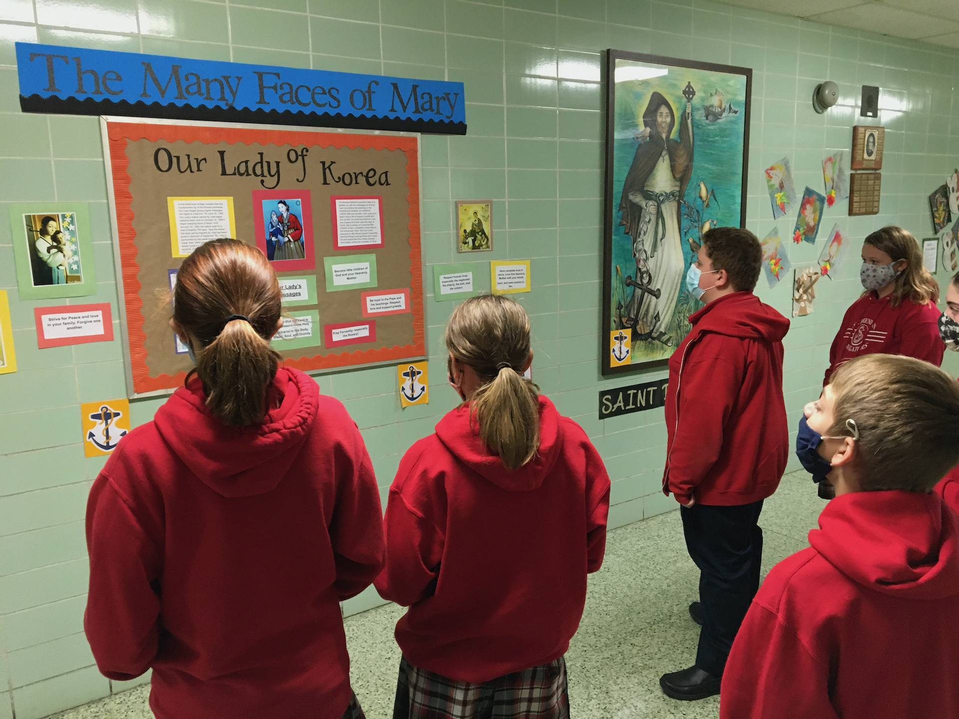 students use the Faces of mary bulletin board to learn about Mary of Korea