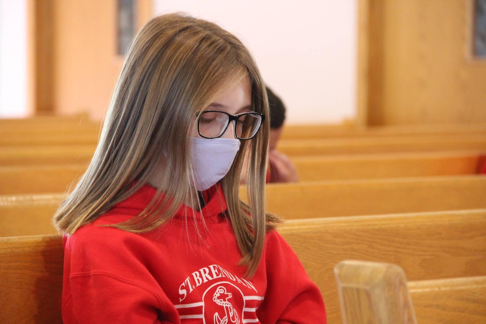 girls sits in meditation during adoration