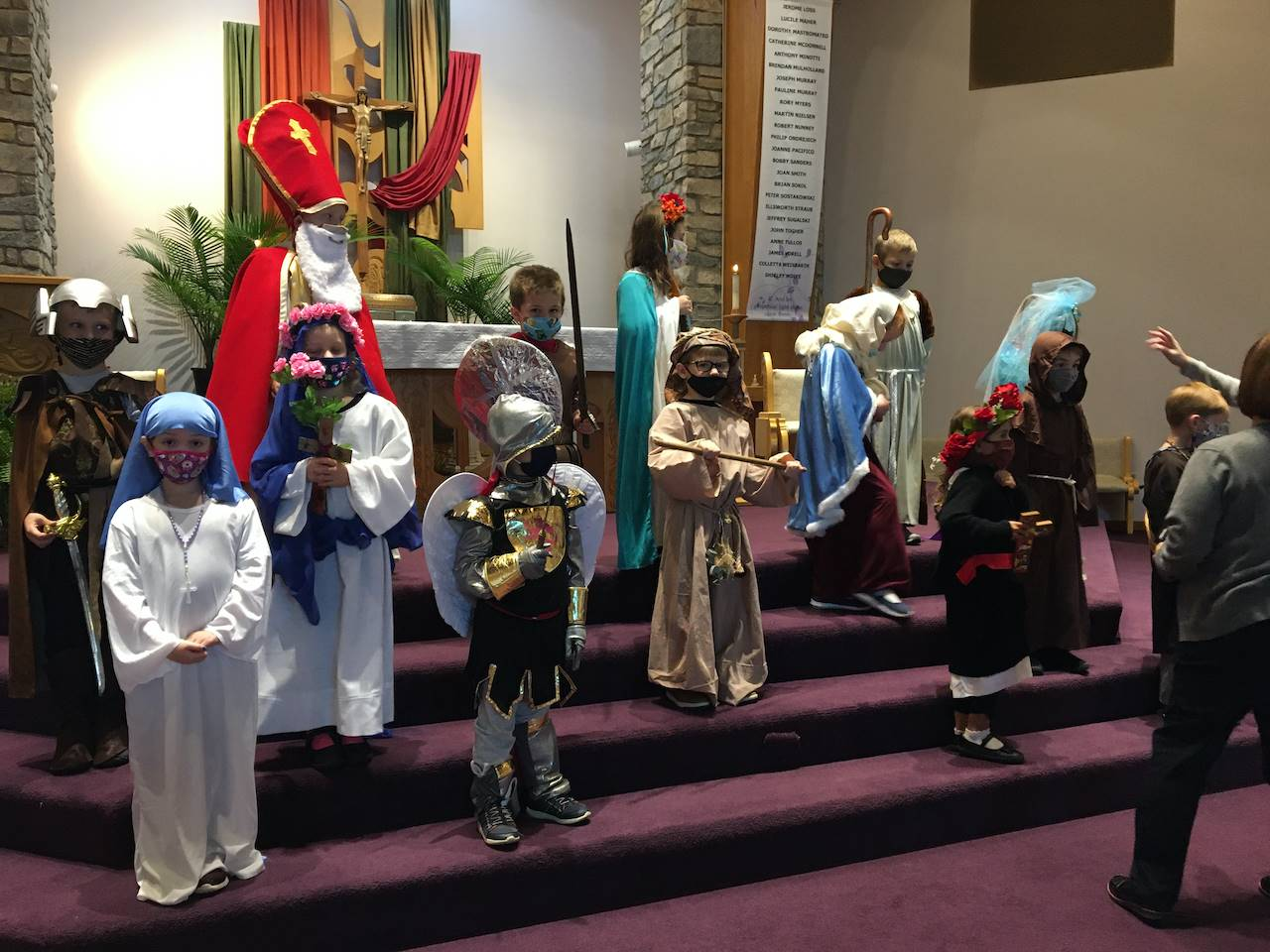 1st graders pose for a picture dressed up as saints