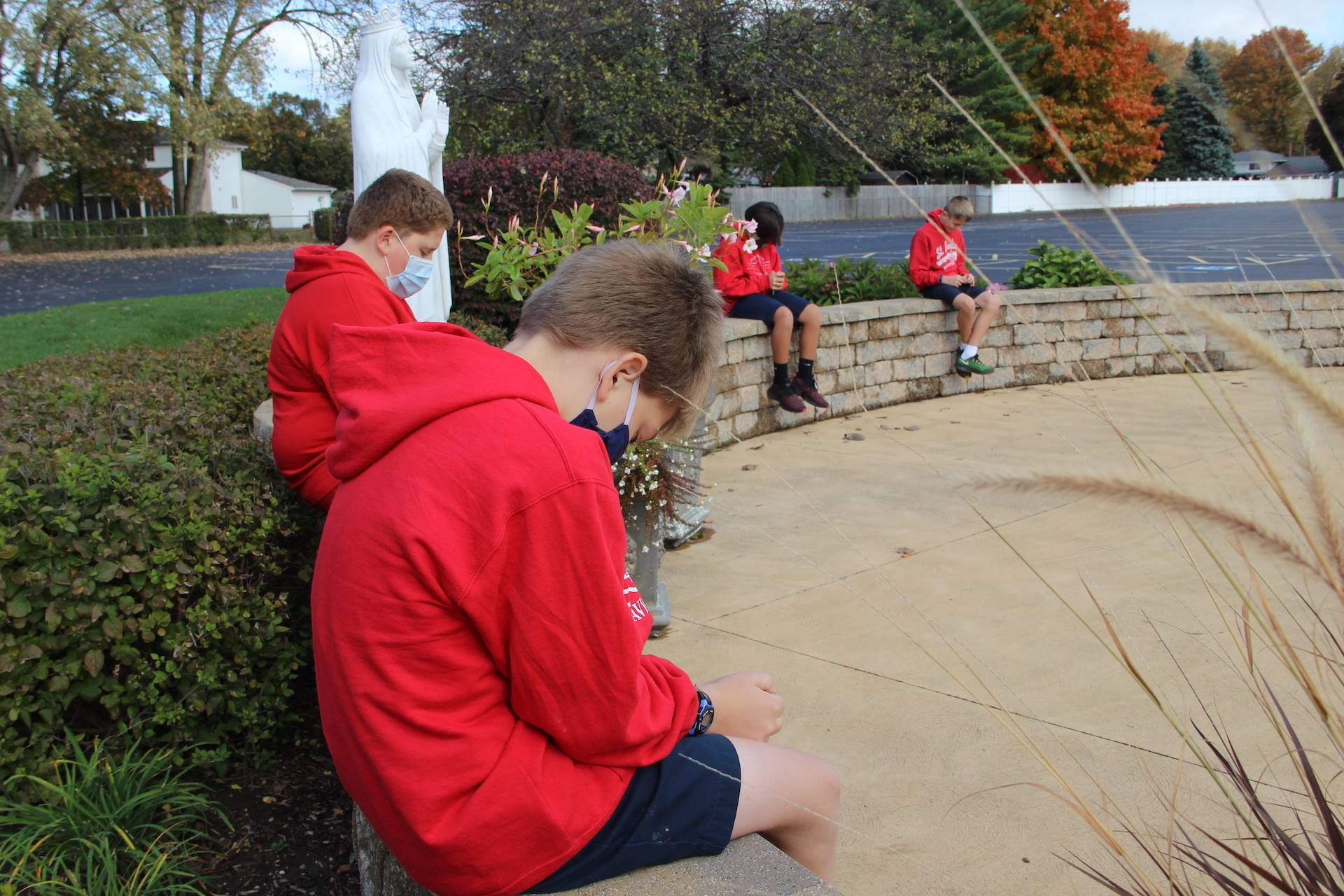 students pray in the our lady of knock prayer garden