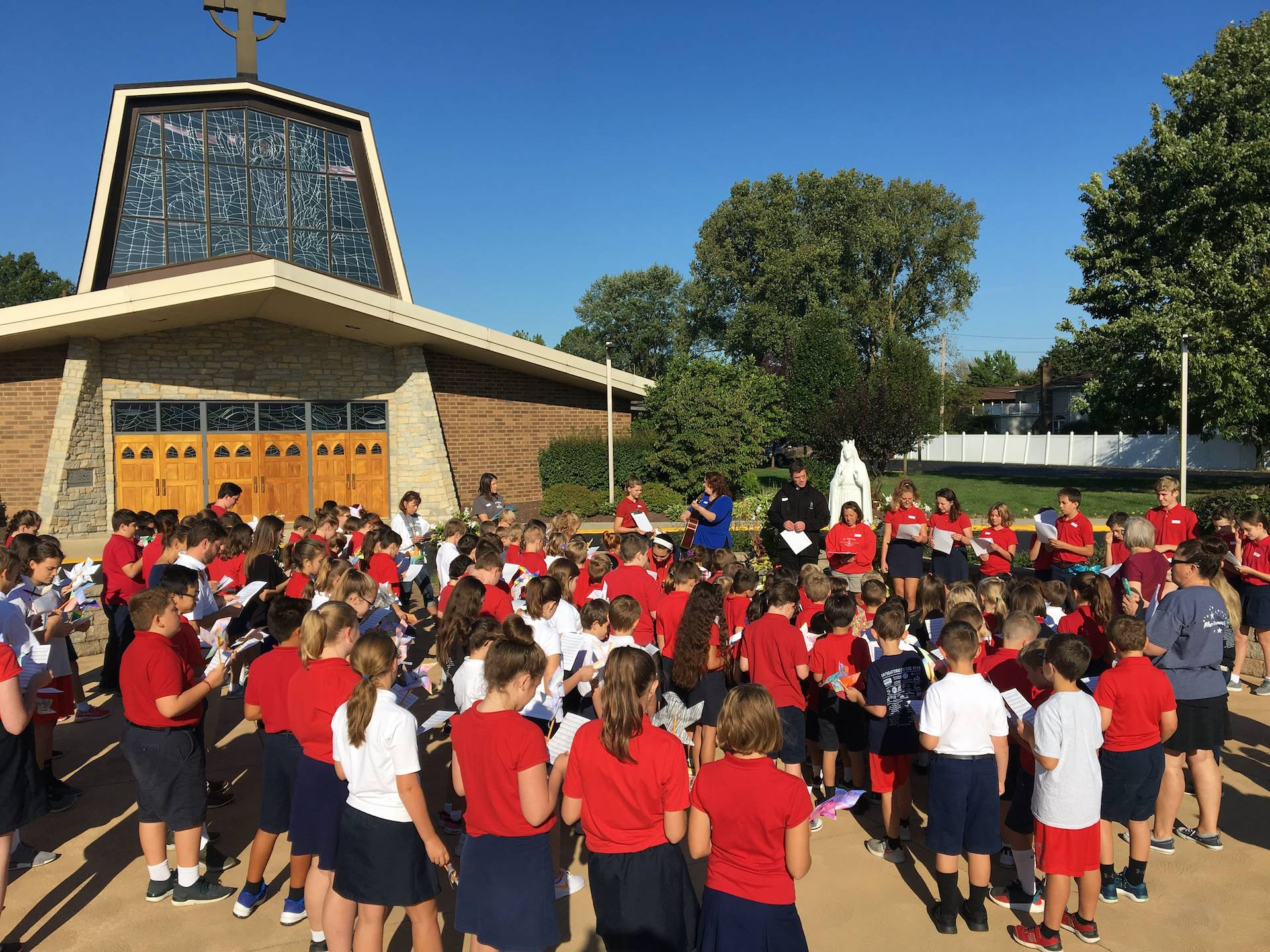 students gather to pray for day of peace