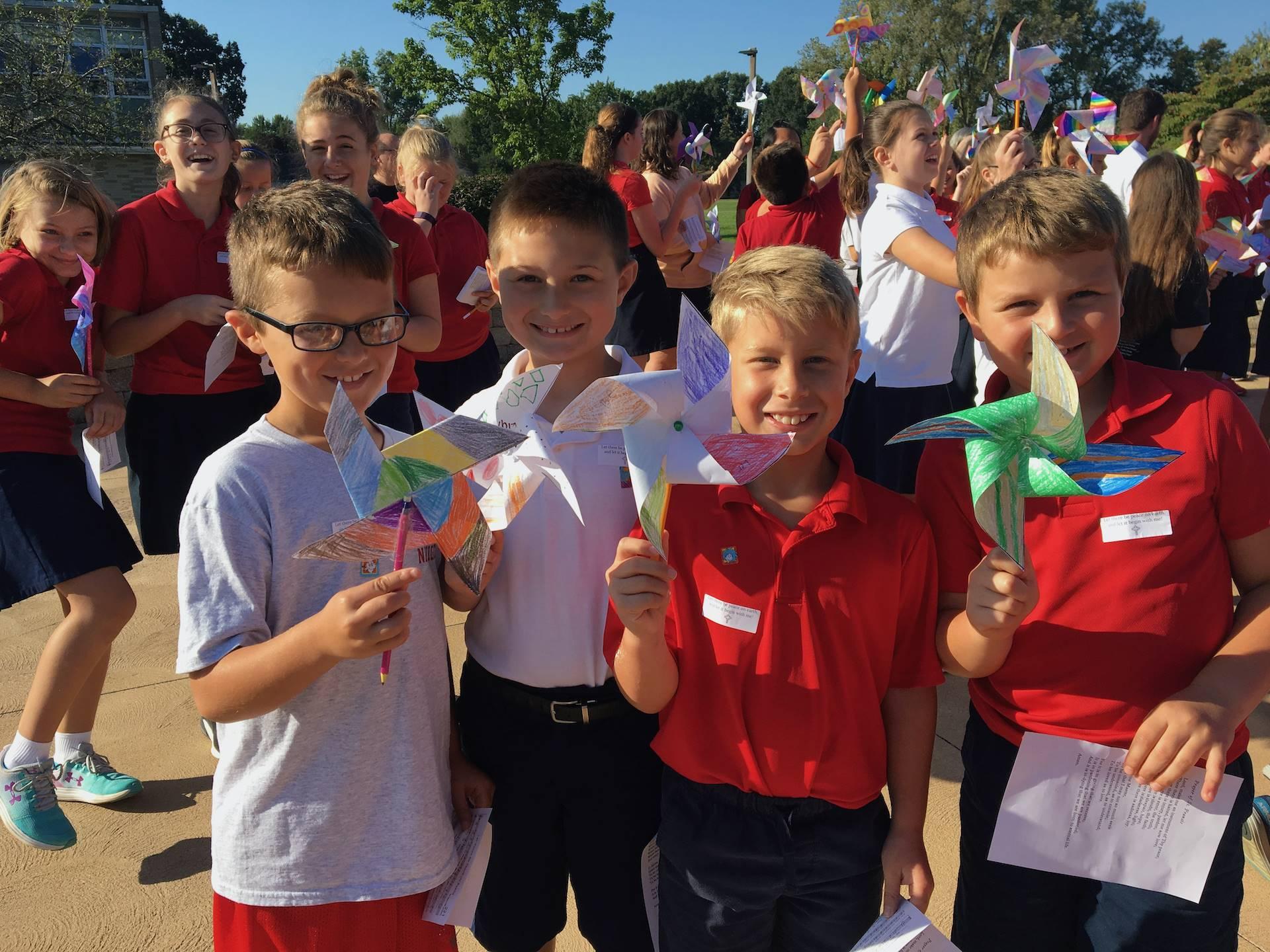 boys show their pinwheels for peace