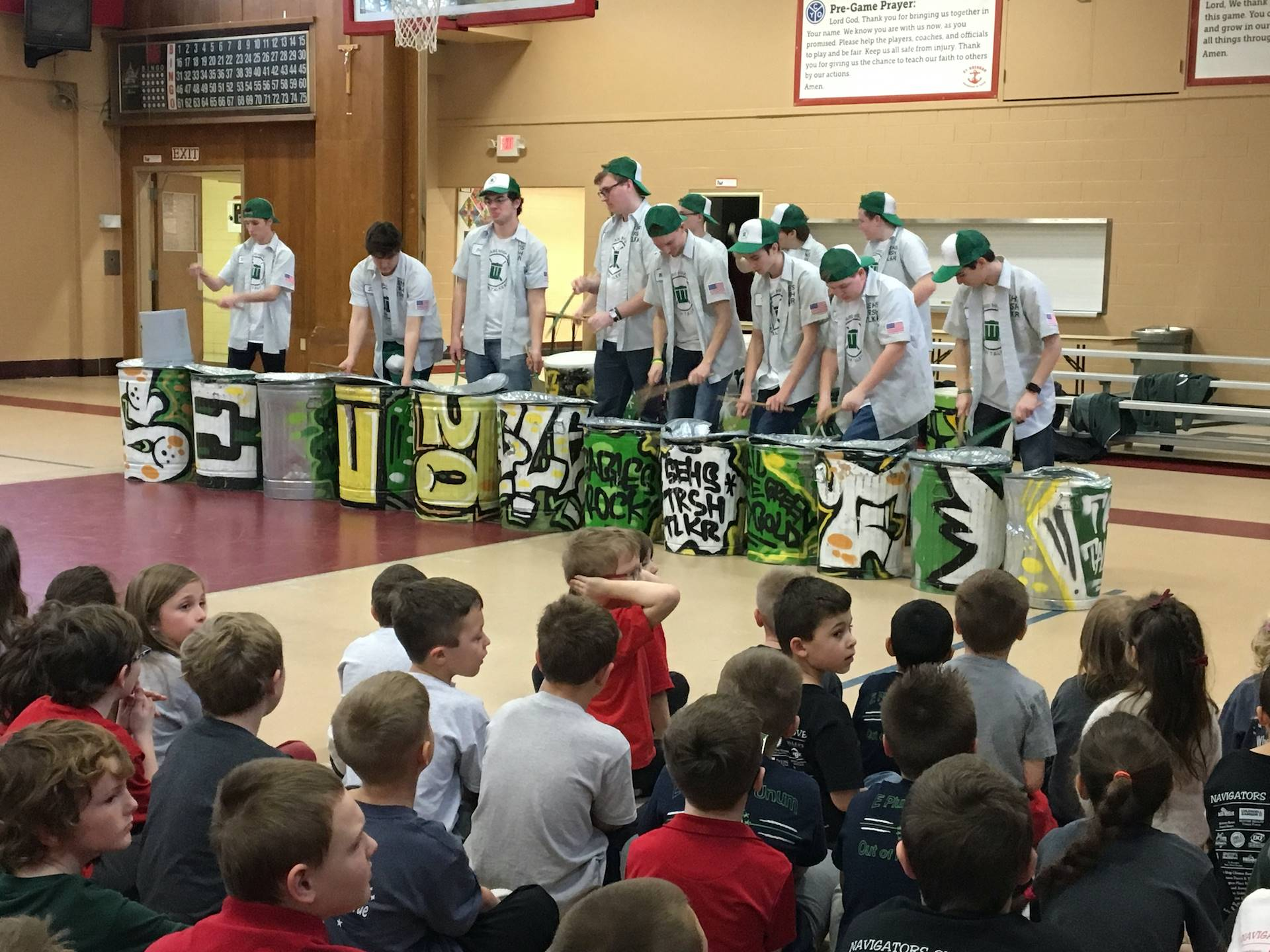st edward trash talkers perform for an assembly