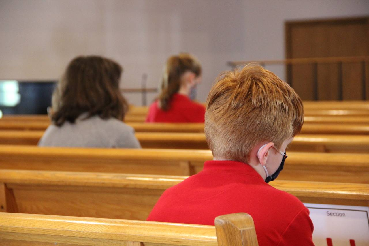 students pray in church