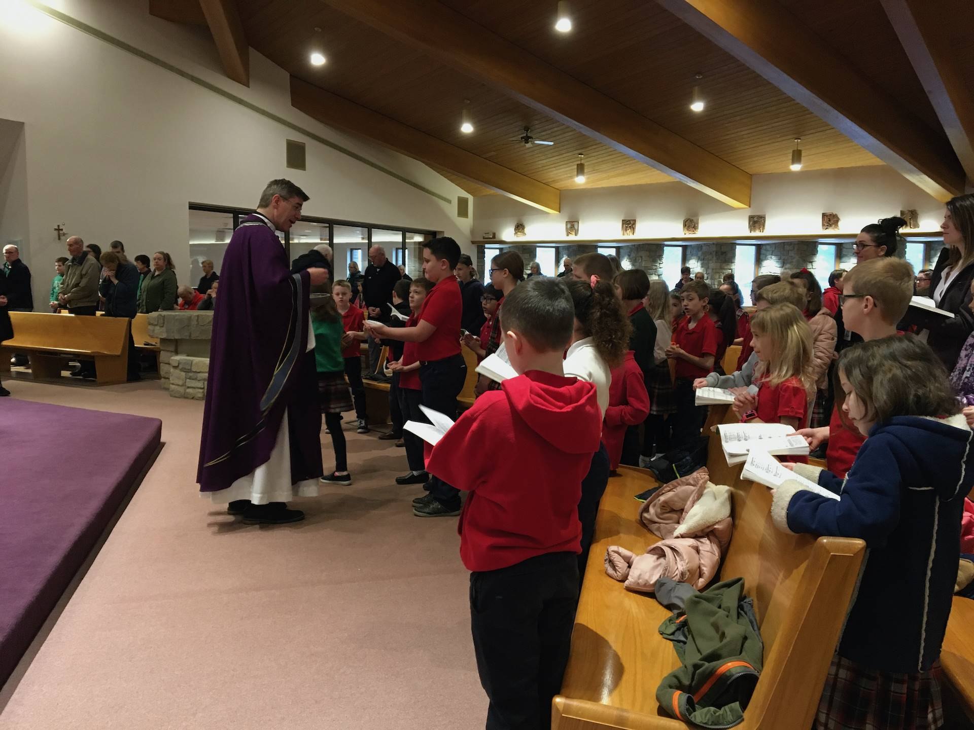 Fr tom distributes communion