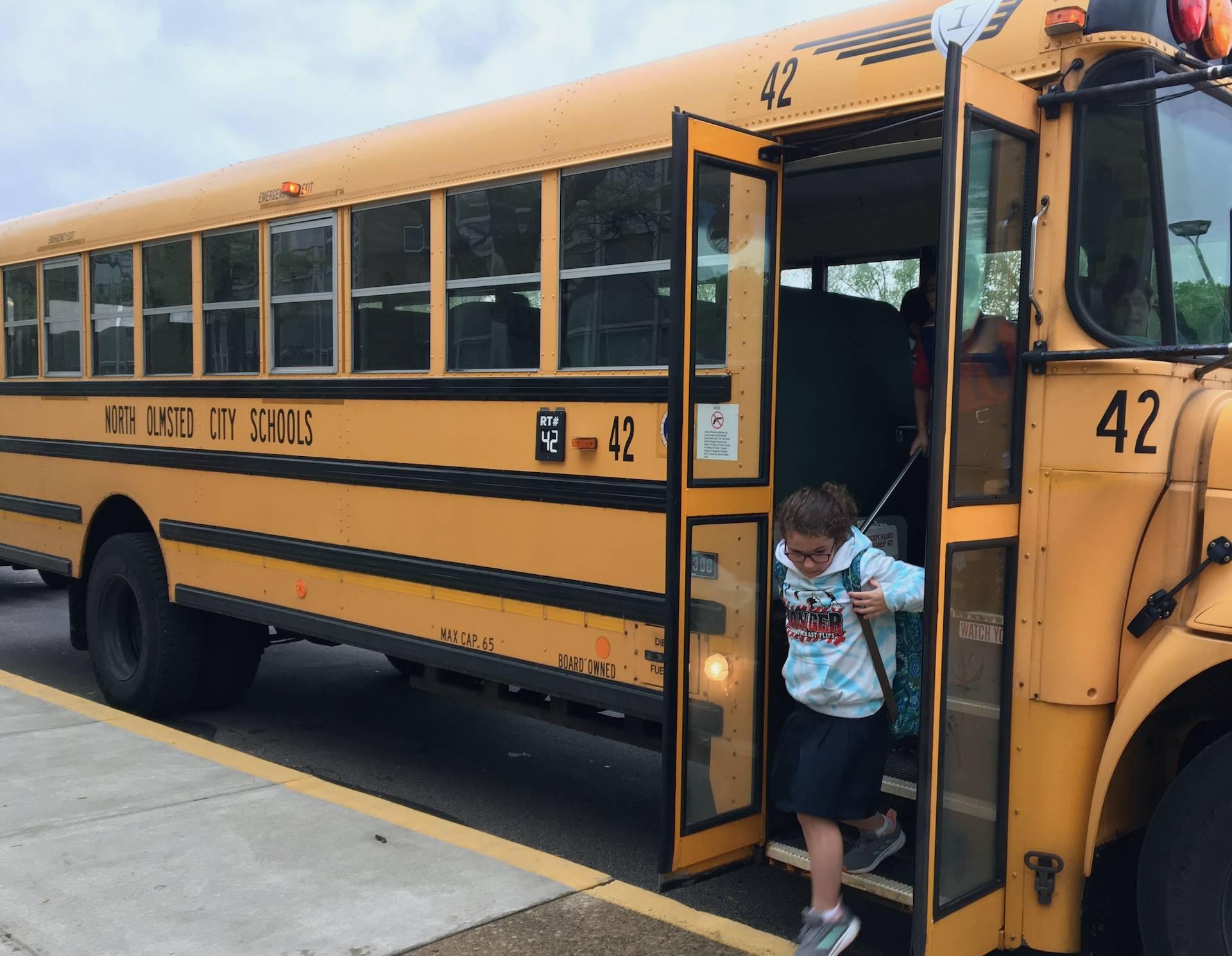student exits school bus
