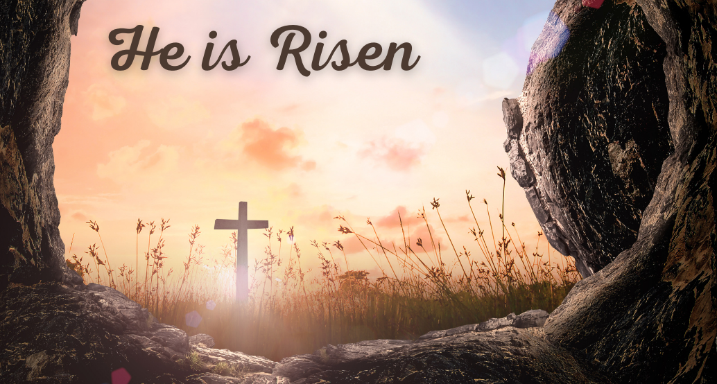 He is risen from an empty cave looking out at a sunrise with a cross
