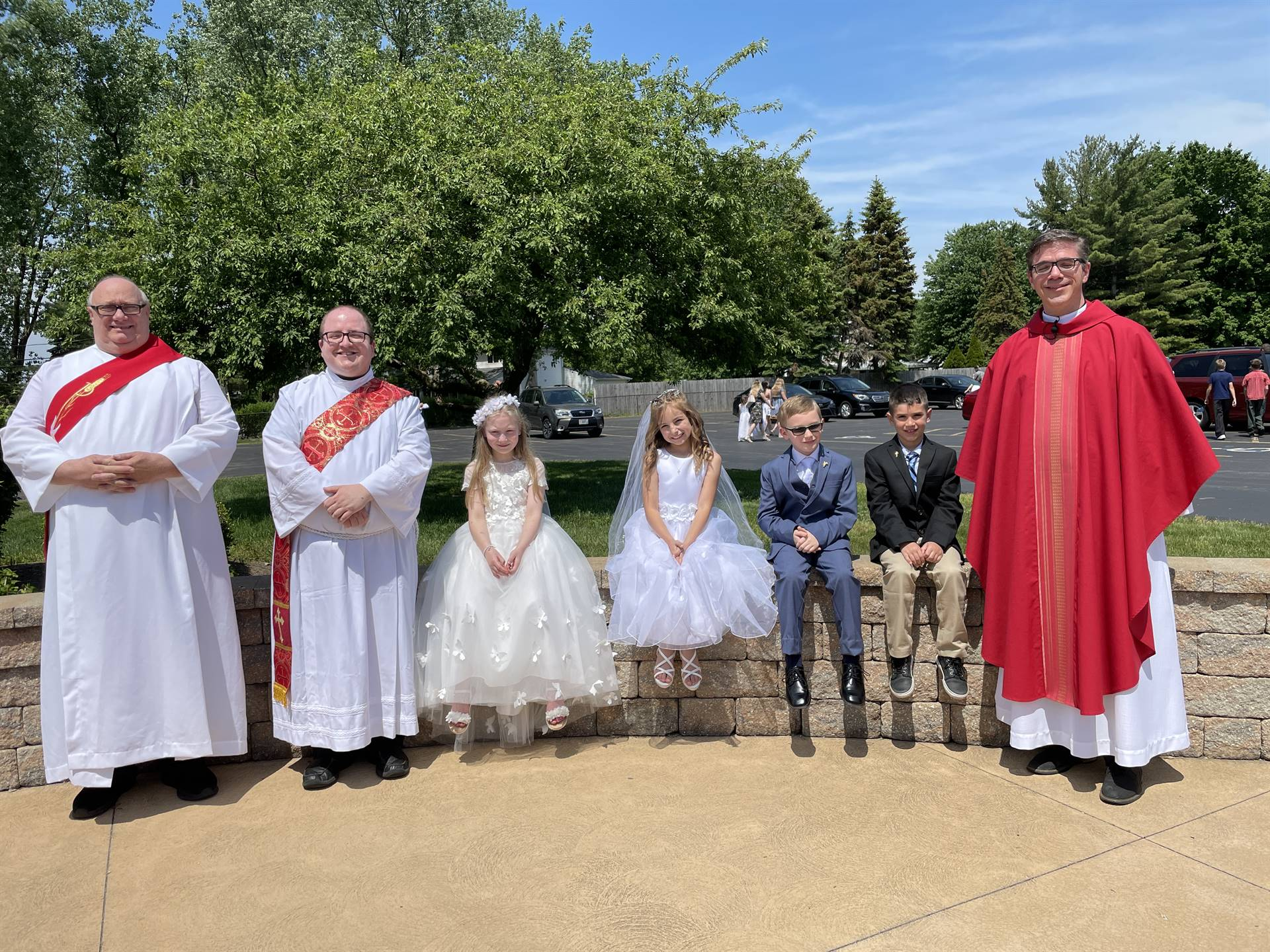 pastor and deacons pose for a photo with the communicants