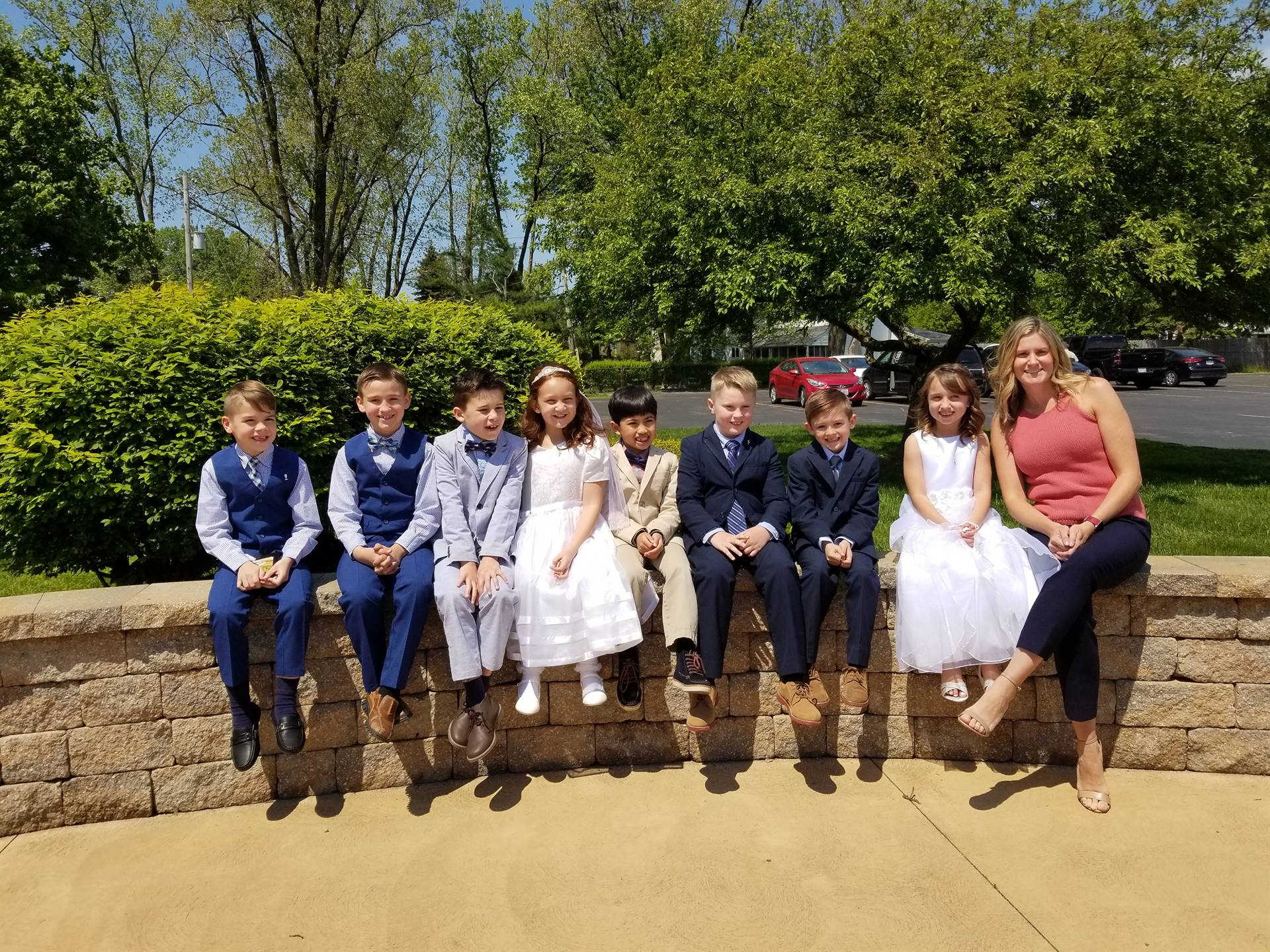 2nd grade teacher celebrate after first communion for the boys and girls