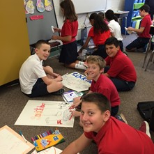 Students make posters to promote the Socktober sock collection
