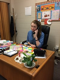Miss Colborn answers the school office phone