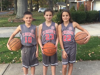 Three Students model the new St. Brendan basketball uniforms
